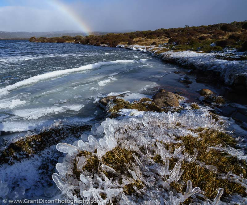 image of Lakeshore ice and rainbow