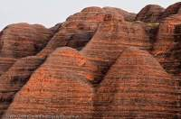AUSTRALIA, Western Australia, East Kimberley, Purnululu National Park (Bungle Bungles).  Layered sandstone domes beside Piccaninny Creek, sunrise.