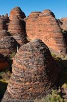 AUSTRALIA, Western Australia, East Kimberley, Purnululu National Park (Bungle Bungles).  Layered sandstone domes beside Piccanniny Creek.