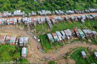 CAMBODIA, Siem Reap. Kompong Phluk village, with houses on stilts due to seasonal flooding of nearby Tonle Sap lake.  Aerial view from ultralight aircraft.