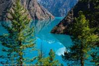 NEPAL, Dolpo. Phoksundo Lake, turquoise glacial outwash water of Nepal's highest (3600m) large lake.