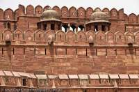 INDIA, Uttar Pradesh, Agra. Red sandstone walls of Agra Fort, rebuilt in present form from 1573 by Mughul emperor Akbar; the most important fort in India, where the great Mughul emperors lived and governed India from; a World Heritage site.