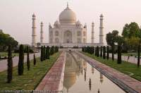 INDIA, Uttar Pradesh, Agra. Taj Mahal, built by Mughul emperor Shah Jahan in 1630 as mauseleum for his queen Mumtaz Mahal, lies within formally laid out gardens. A World Heritage site and considered one of the new 7 wonders of the world.