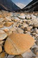 INDIA, Uttaranchal, Gangotri. Polished boulders beside Bhagirarthi River, main tributory of the Ganges.
