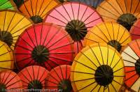 LAOS, Luang Prabang. Coloured paper umbrellas in Luang Prabang night market.