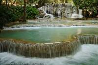 LAOS, Luang Prabang. Limestone-dammed (rimstone) pools immediately downstream of Tat Kuang Si waterfall.