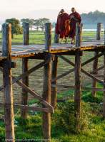 Monks crossing U-Bein bridge, at 1200 metres the world's longest teak foot bridge.