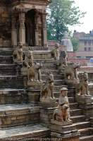 NEPAL. Bhaktapur, Kathmandu valley. Stone guardians flanking stairway at 17th century Siddhi Lakshmi Temple, Durbar Square.