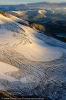 NORWAY, Oppland, Jotunheimen National Park. Ogives (seasonal layering) exposed in surface of Fannarakbreen glacier, sunrise.