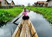 Boat woman at lakeside village, Inle Lake