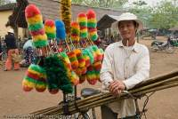 VIETNAM, Central, Hue. Feather dusters for sale at market, near Thanh Toan covered bridge.